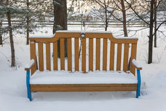 Bench to rest covered with snow Royalty Free Stock Photos