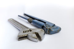Bench tool and an adjustable pipe wrench Royalty Free Stock Images