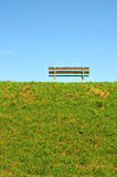 A bench on top of the dike Stock Photos