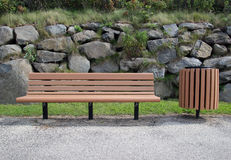 Bench and trash can. A park bench and trash can in a public place Royalty Free Stock Photos