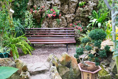 Bench in tropical park Stock Photography
