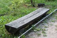 Bench from the trunk of tree Stock Images