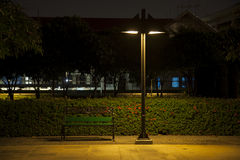 Bench under lamp Royalty Free Stock Photos