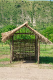 Bench under reed roof Royalty Free Stock Images