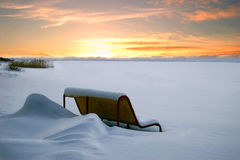 Bench under snow royalty free stock photo