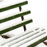 Bench under snow Royalty Free Stock Image
