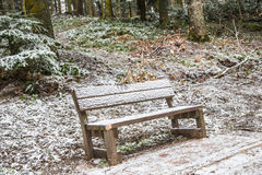 Bench under snow Royalty Free Stock Images