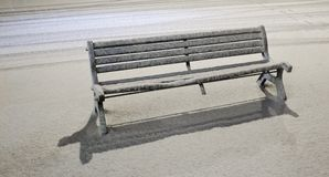 Bench under snowfall Stock Photos