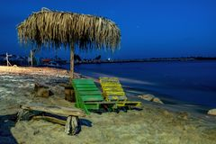 Bench on the night shore of the sea. royalty free stock photography