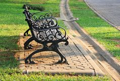 Bench under the tree in the Gardens Royalty Free Stock Photography