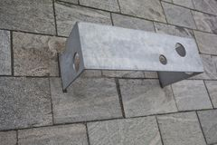 Bench with an unusual design on the street covered with natural stone Stock Images