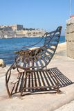 Bench in Valetta, Malta. Bench in Valetta Harbor with typical Maltese architecture. Island of Malta, Europe. Famous holiday destination due to the unique view Royalty Free Stock Images