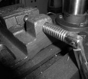 Bench Vice. This image shows part of a hand Bench Vice on a work bench, placed on top of a bench Drill Press Royalty Free Stock Photography