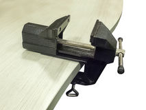 Bench vice on table Royalty Free Stock Photo