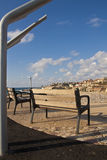 Bench with a view. Bench on a hill with a view toward the old city of Jaffa - Israel Royalty Free Stock Photos