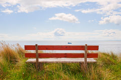 Bench with a View. Inviting bench overlooking sunny Scottish coastal scene Stock Photography