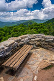 Bench and view of the Appalachians from Craggy Pinnacle, near th. E Blue Ridge Parkway, North Carolina Royalty Free Stock Photography