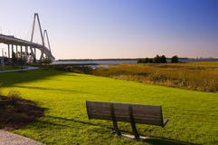 Bench with View of Bridge and Marsh Stock Photo