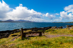 Bench with view over Irish coastline royalty free stock images