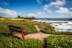 Bench and view of Piegon Point Lighthouse in Pescadero, Californ Royalty Free Stock Photo