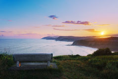 Bench with view of Sopelana coast at sunrise Stock Photography