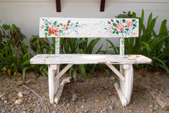 Bench. Vintage white bench in garden Royalty Free Stock Image