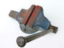 Bench vise. Old used bench vise on white background Stock Photography