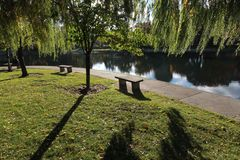 A bench in Wade Park in front of Wade Oval. Wade Park is a park in the University Circle neighborhood of Cleveland, Ohio. Wade Park today largely serves as the royalty free stock images