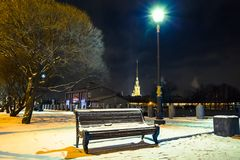 Bench, walkway covered snow and street light at night. Winter cityscape in Saint Petersburg, Russia. stock images