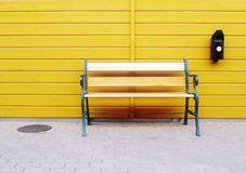 Bench wall. Wall and bench outside by ashtray Royalty Free Stock Photos