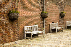 Bench by the wall Stock Image