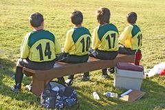 Bench warming. Young lads warming the bench at local soccer game Stock Photos