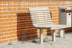 Bench and waste container Stock Photo