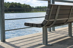 Bench by water Royalty Free Stock Images