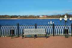 The bench on the waterfront. The bench near the waterfront of a wide river Stock Photography