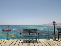 Bench on the wharf. Red Sea. Bench on the wharf at the Red Sea Royalty Free Stock Photos