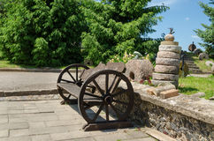Bench wheel carriage rail stacked tower millstones Stock Photo