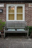 Bench and Window in Garden Royalty Free Stock Photo