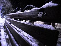 A bench in the winter stock photos