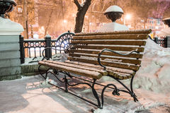 Bench in winter city park Royalty Free Stock Image