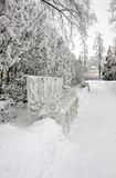 Bench in winter park. A vertical picture Royalty Free Stock Photo
