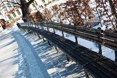 Bench in winter park Stock Photos