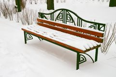 Bench in winter park Stock Photos