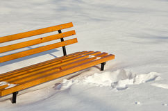 Bench in winter park on a background of snow, New Year Christmas. Royalty Free Stock Photos