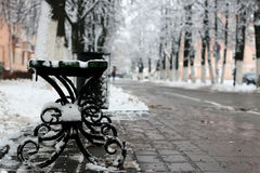Bench winter sidewalk Royalty Free Stock Photo