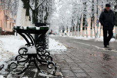 Bench winter sidewalk Royalty Free Stock Photos