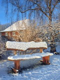 Bench in winter snow, Lithuania Royalty Free Stock Photos