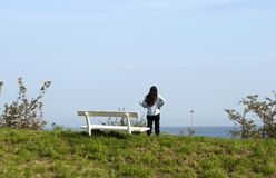 Bench and woman stock photography