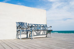 Bench on wooden floor in the beach. royalty free stock images