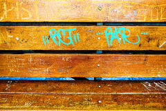 Bench. The wooden bench with the ligth-blue graffity Royalty Free Stock Photo
